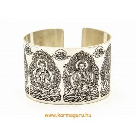 Ezüst színű, vastag karkötő Buddhákkal